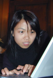 Yammie Yuen typing on a laptop