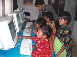 Photo of kids using computers.