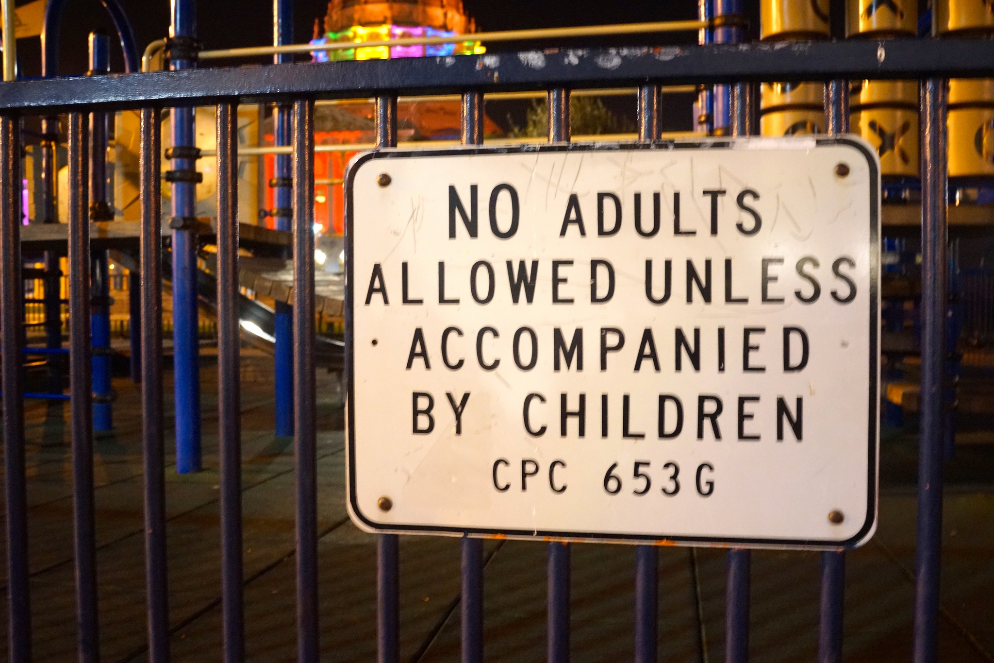A sign next to a children's play area reading No Adults Allowed Unless Accompanied By Children