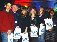 Participants with W3C bags and info material at the New Years event