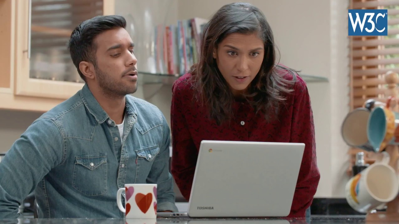 video screenshot of two people talking while watching a computer screen