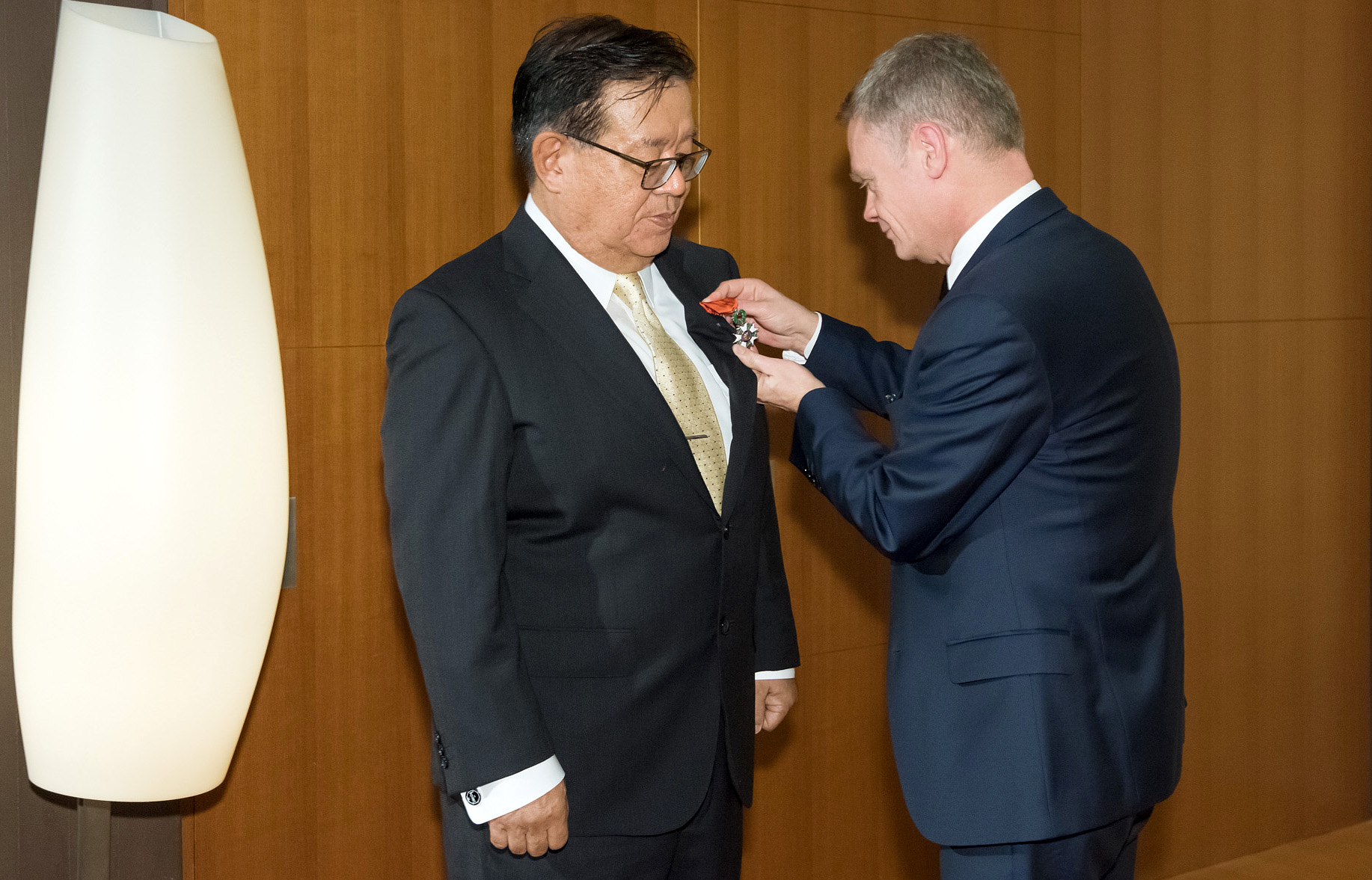 Laurent Pic decorating Jun Murai with the Knight of the Legion of Honour Medal