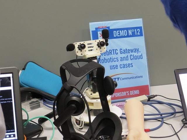 Demo table showing WebRTC gateway by sponsor NTT Communications
