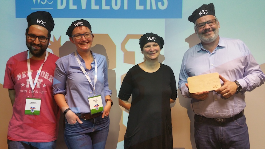 All #devmeetup18 speakers wearing a W3C cooking cap