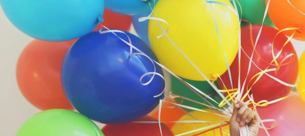 [Photo of colorful balloons]